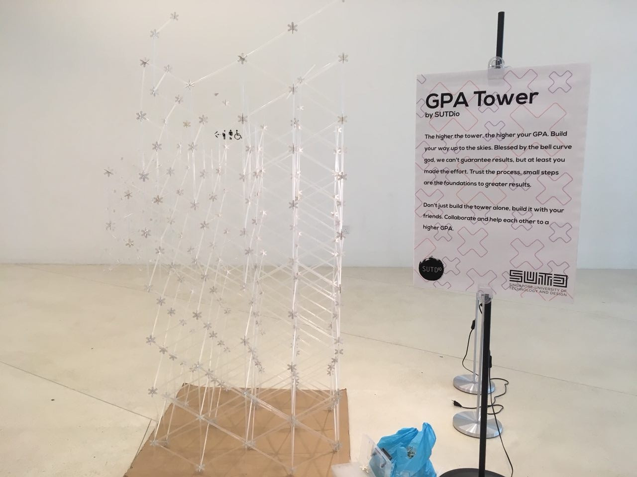 An interactive exhibit. The GPA tower asks visitors to collaborate with each other to build a higher GPA.