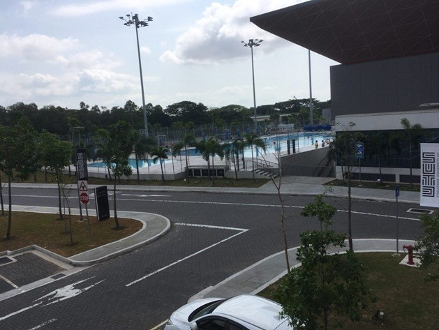The tour ends with a view of the swimming pool (within the Sports and Recreational Centre) from one of the hostel lounges.