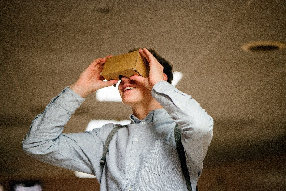 These days, you can make VR viewers with just cardboard and the help of online tutorials. Slot your phone in and be whisked off to another world! Or buy pre-made ones if lazy.