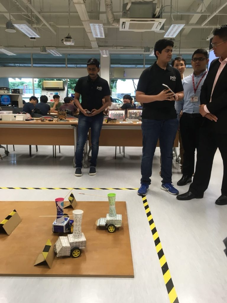 Students showcasing their projects. These robots, powered by the Arduino open-source electronic prototyping platform, are able to do combo moves!